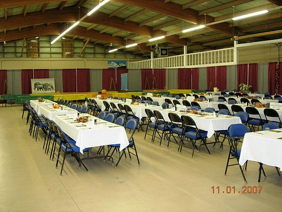 Trowbridge Pavilion hall with empty tables and chairs