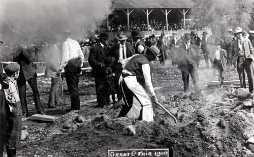 Black and white photo of man digging